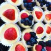 Mini Cheesecakes topped with Fresh Berries