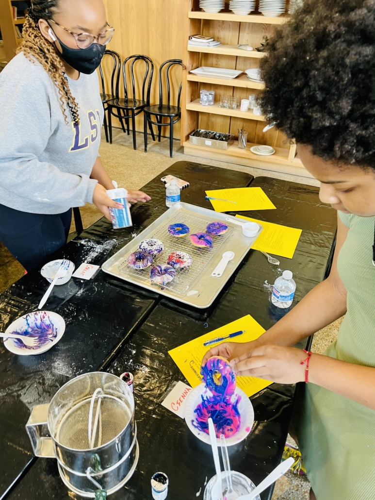 kids make galaxy donuts during baking with a purpose at the southern food and beverage museum baking tutorial pastry baked goods dessert nola